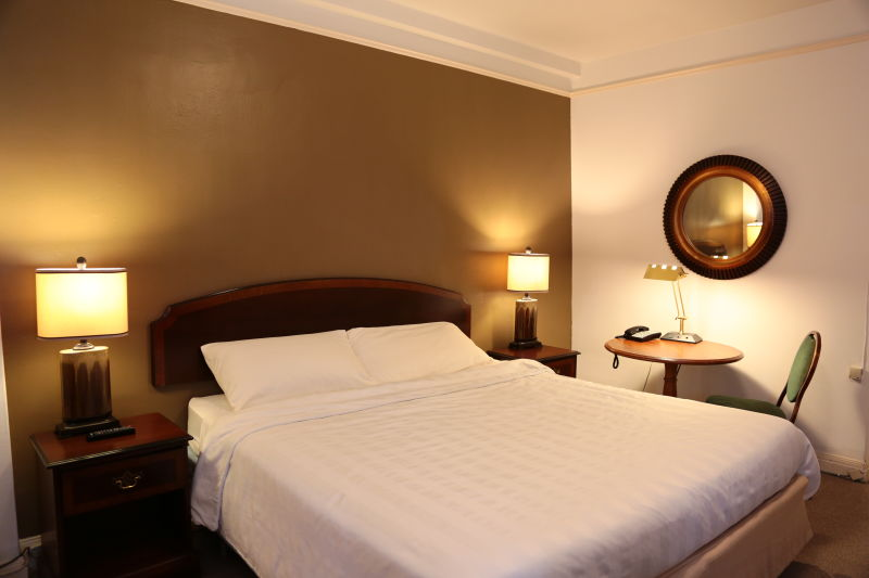 Nash Hotel - a King Size bed room